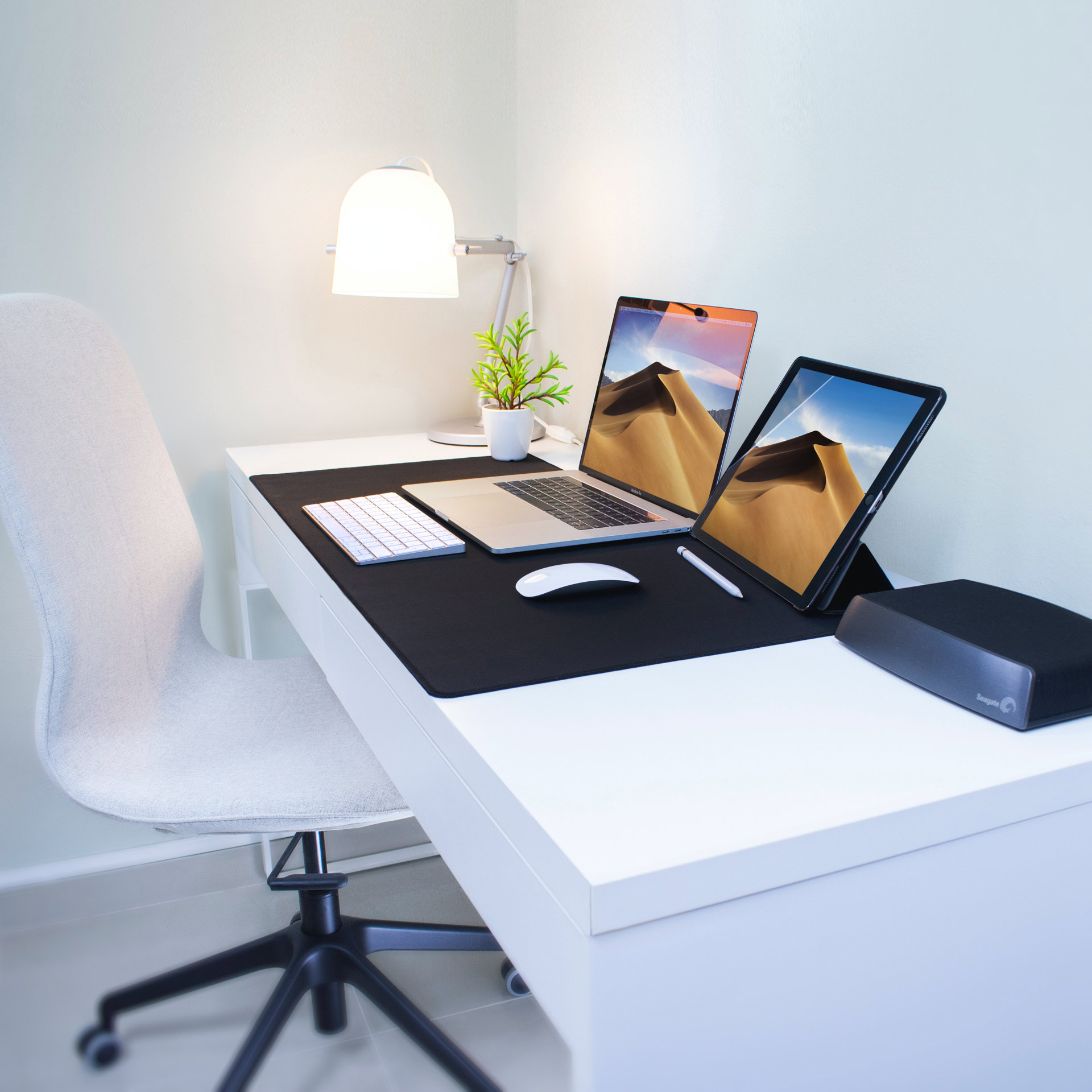 white office with a surface laptop and surface tablet and a wireless keyboard and wireless mouse