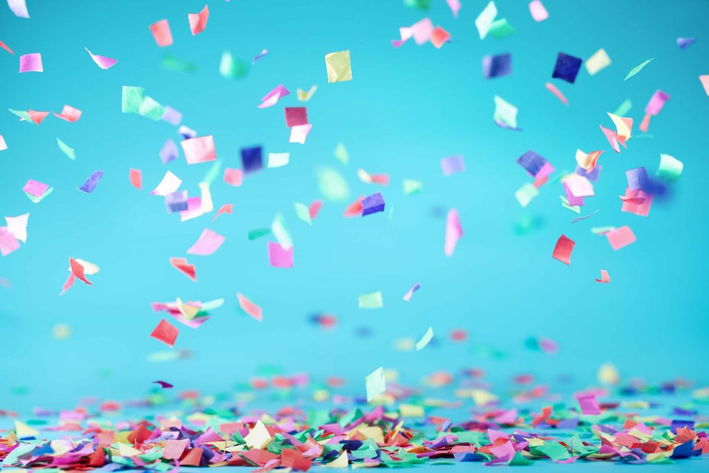 confetti falling from above and collecting on surface.