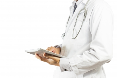 torso of a doctor with an ipad in hand