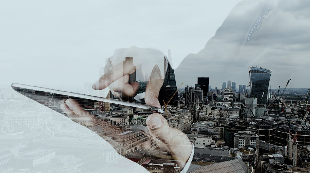 Double-Exposure-Businessman-w-Tablet-Cityweb