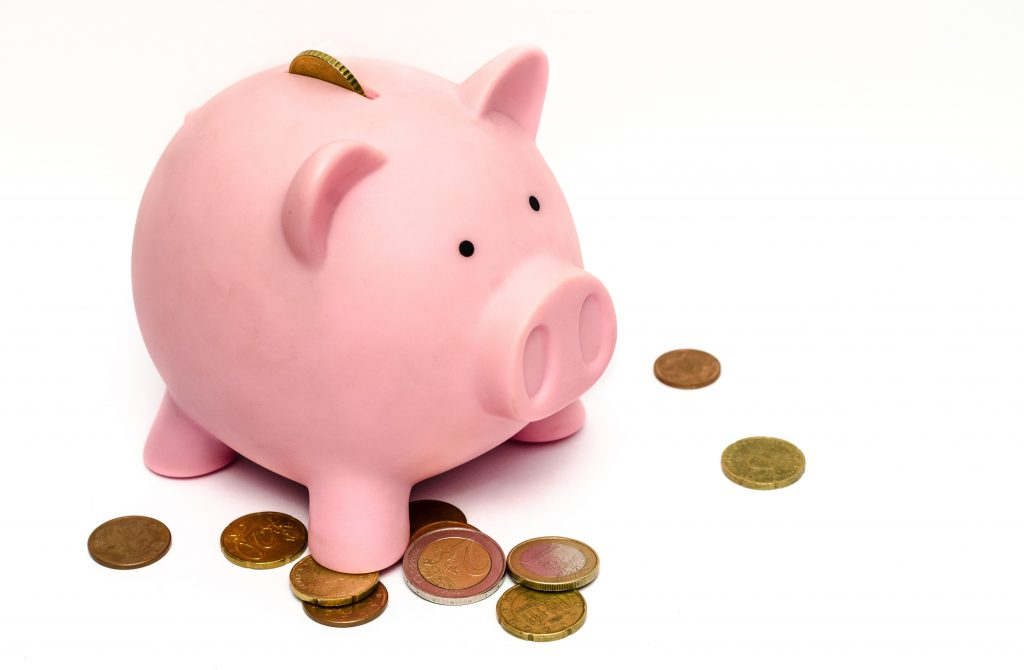 piggy bank with coins afoot