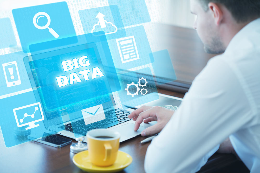 man looking at a conceptualization of big data