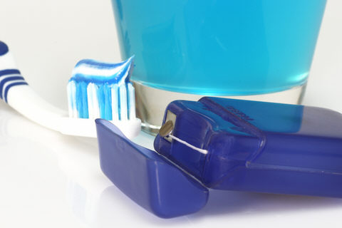 toothbrush, floss and mouthwash