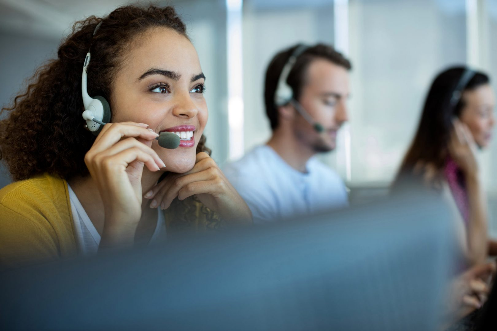 woman with a phone headset one sitting on a call center