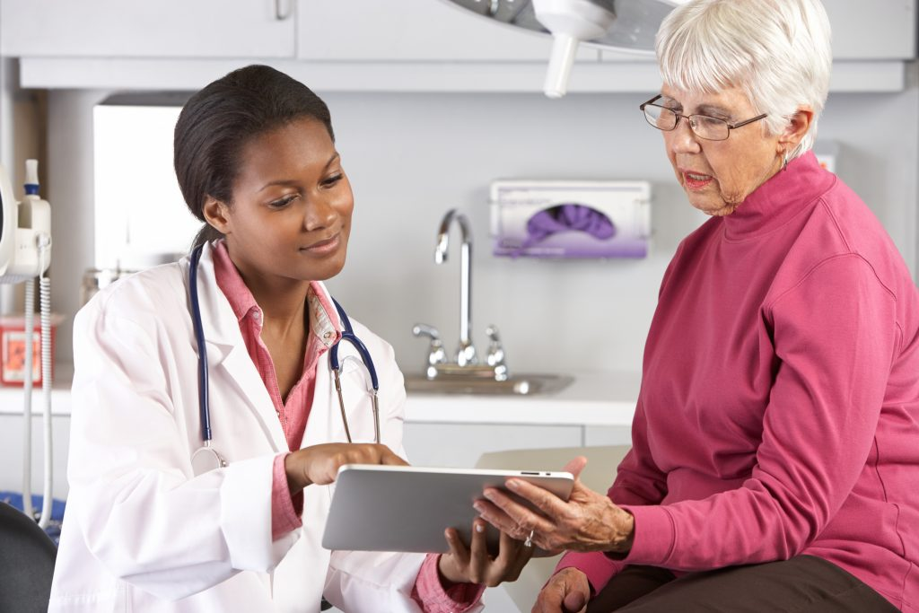 doctor with patient looking at ipad